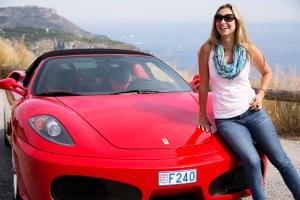 Julia driving a Ferrari in Italy.